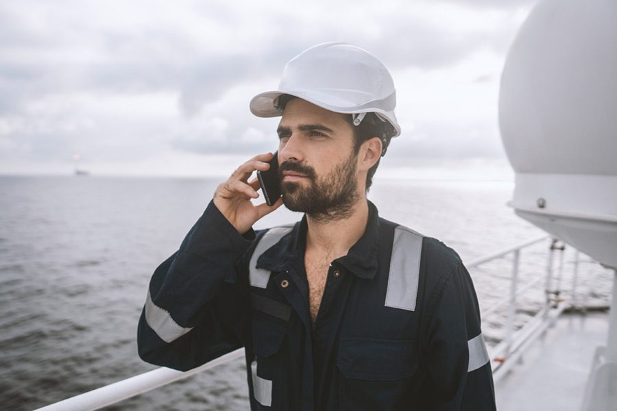 Crew Member using mobile phone on deck